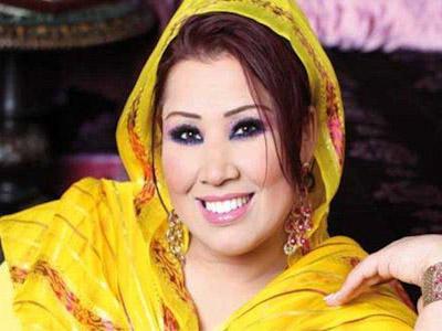 """سعيدة شرف تجر حمزة """"مون بيبي"""" وصحفية مغربية للقضاء"""